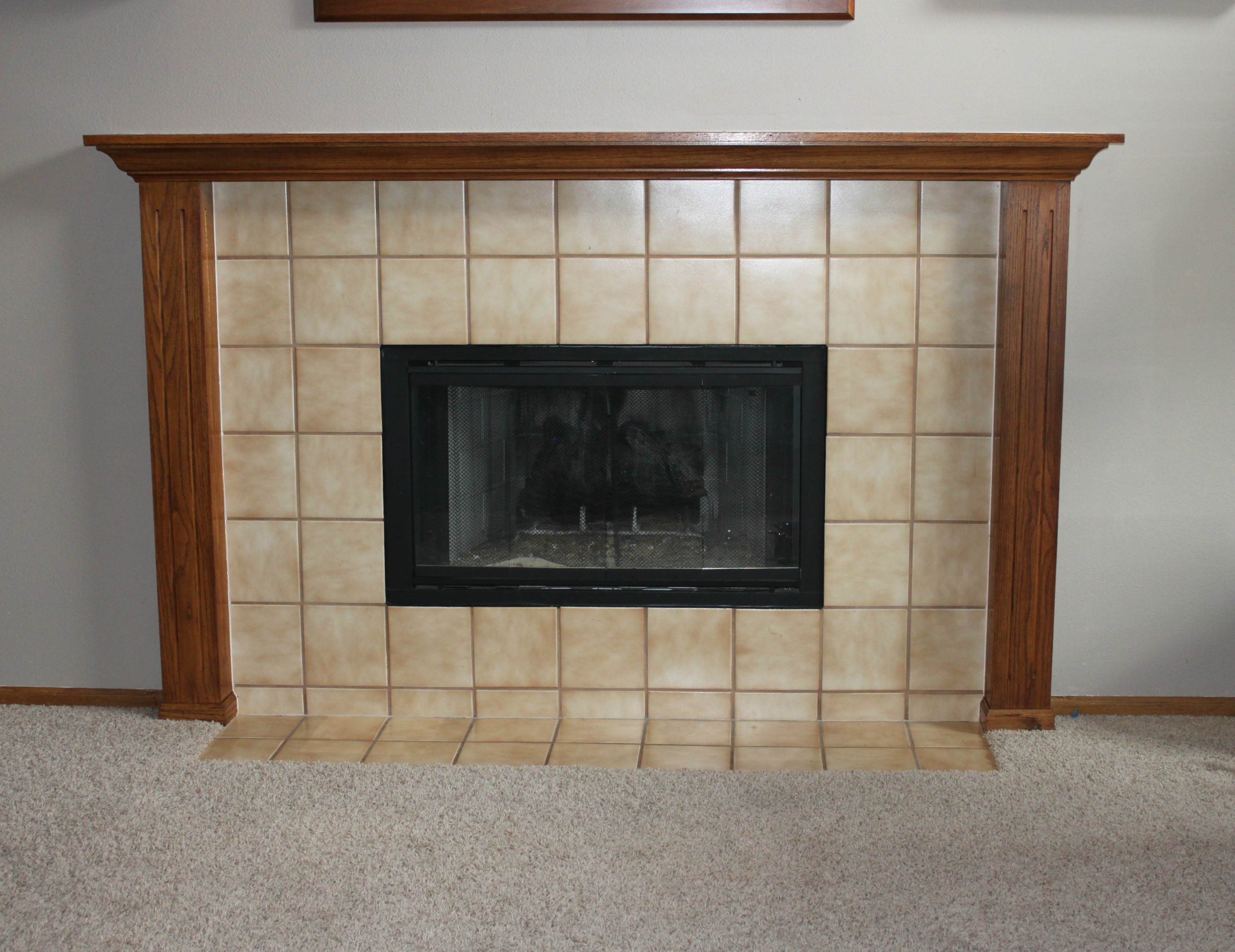 Check out this quick and easy fireplace update for tips on getting rid of brass or outdated fireplace doors and other accents.