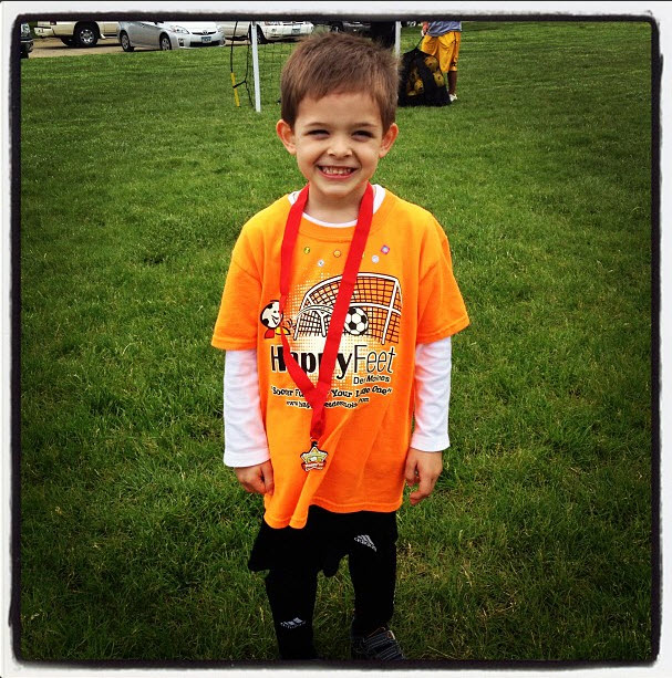 Carter with his soccer medal