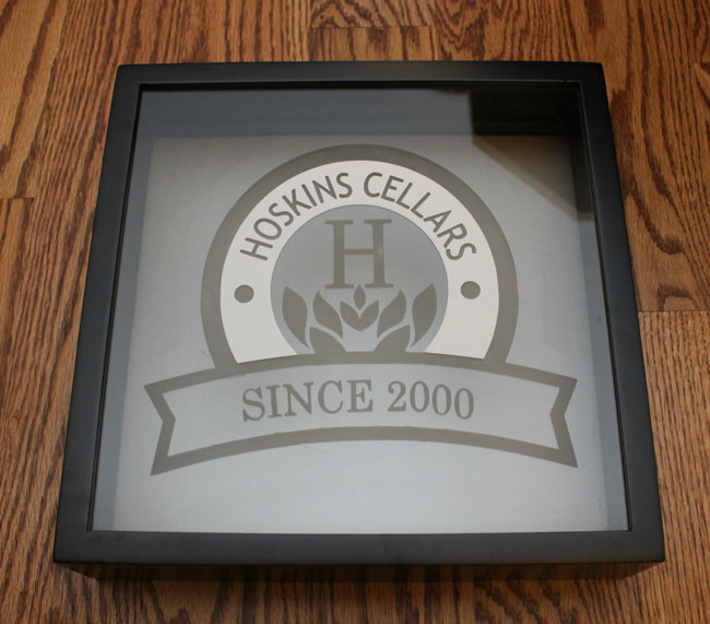 wine cork shadow box with etched design - removing stencil
