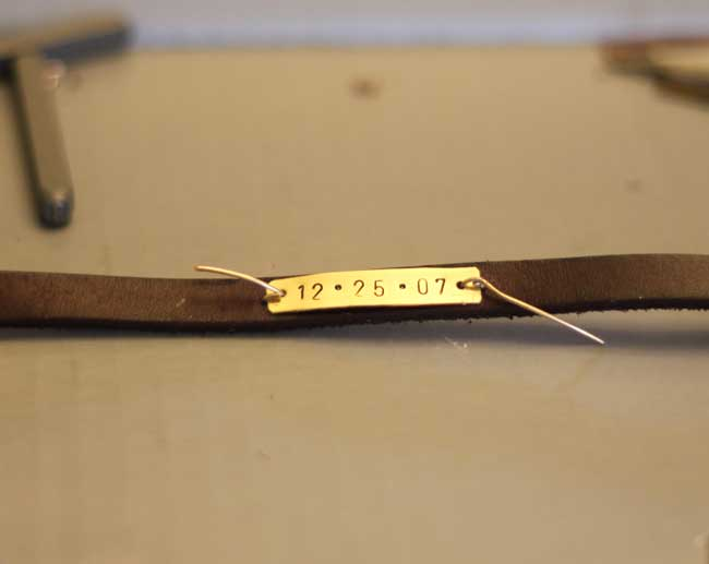 leather wrap bracelet with metal stamped birth date - fasten with wire
