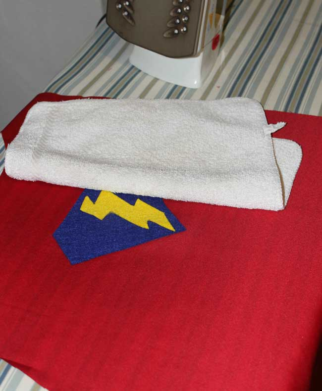 super hero capes - iron on emblems before sewing