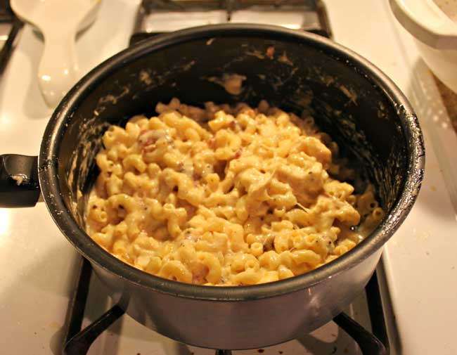 mac and cheese with bacon - stir noodles and bacon into cheese sauce