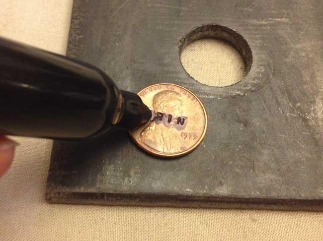 Hand stamped penny keychain - letter darkening