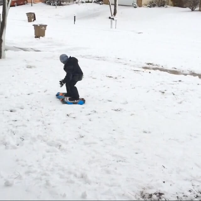 Snowboarding with a sled